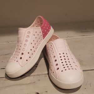 Native pink slip on water shoes